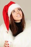 Mujer joven en el sombrero de santa Fotografía de archivo