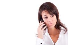 Mujer joven en el teléfono Fotografía de archivo libre de regalías