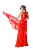 Mujer joven en el vestido rojo aislado en el fondo blanco Fotos de archivo libres de regalías