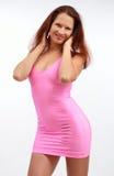 Mujer joven en el vestido rosado foto de archivo libre de regalías