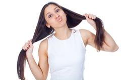 Mujer joven en expresiones positivas Fotografía de archivo libre de regalías