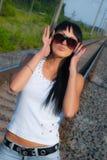 Mujer joven en gafas de sol Imágenes de archivo libres de regalías