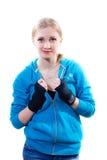 Mujer joven en guantes de boxeo Fotografía de archivo libre de regalías