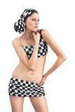 Mujer joven en juego checkered sobre blanco Imagen de archivo libre de regalías