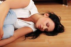 Mujer joven en la depresión. Foto de archivo libre de regalías