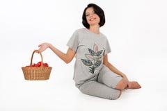 Mujer joven en la ropa casera Imágenes de archivo libres de regalías