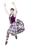 Mujer joven en la ropa para la danza del escocés imagenes de archivo