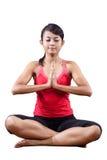 Mujer joven en la yoga que estira ejercicio imagen de archivo