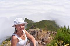 Mujer joven en nubes Foto de archivo libre de regalías
