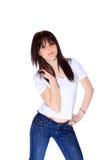 Mujer joven en pantalones vaqueros y camiseta Imágenes de archivo libres de regalías