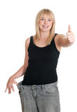 Mujer joven en peso perdido de los pantalones de gran tamaño Imágenes de archivo libres de regalías