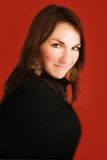 Mujer joven en rojo Imagen de archivo