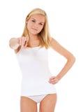 Mujer joven en ropa interior que señala con el finger Foto de archivo libre de regalías