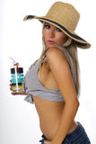 Mujer joven en sombrero de paja del verano Fotografía de archivo