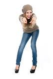 Mujer joven en suéter que señala el finger en la cámara Fotografía de archivo