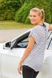Mujer joven en su nuevo coche Imágenes de archivo libres de regalías