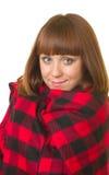 Mujer joven en tela escocesa controlada Imagenes de archivo