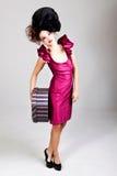 Mujer joven en traje de la vanguardia Imagenes de archivo