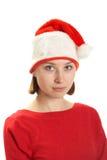 Mujer joven en un casquillo de Papá Noel Imagen de archivo libre de regalías