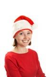Mujer joven en un casquillo de Papá Noel Fotografía de archivo libre de regalías