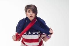 Mujer joven en un jersey rayado Fotos de archivo