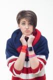 Mujer joven en un jersey rayado Imagenes de archivo