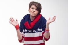 Mujer joven en un jersey rayado Fotografía de archivo libre de regalías