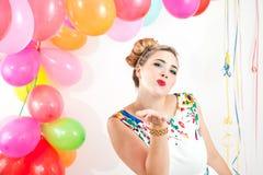 Mujer joven en un partido Foto de archivo libre de regalías