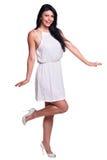 Mujer joven en un vestido blanco del verano aislado sobre blanco Imagen de archivo libre de regalías
