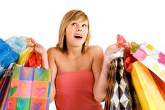 Mujer joven en una juerga de compras Foto de archivo libre de regalías