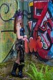 Mujer joven en una máscara del traje Fotos de archivo