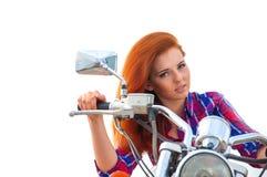 mujer joven en una motocicleta Fotos de archivo libres de regalías