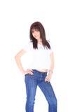 Mujer joven en vaqueros y camiseta Imagen de archivo libre de regalías