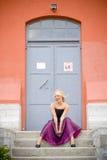 Mujer joven en vestido formal Fotografía de archivo libre de regalías