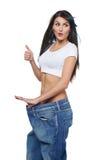 Mujer joven encantada con ella resultados de dieta Imagen de archivo libre de regalías