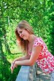 Mujer joven entre árboles Imágenes de archivo libres de regalías