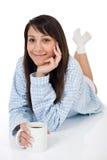 Mujer joven feliz con café en pijamas Imágenes de archivo libres de regalías