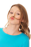 Mujer joven feliz con el bigote del pelo Foto de archivo libre de regalías