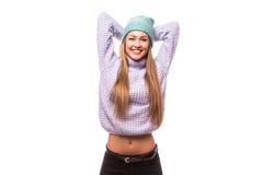 Mujer joven feliz con el casquillo en la cabeza Imagen de archivo