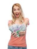 Mujer joven feliz con el dinero euro del efectivo Imagen de archivo
