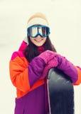 Mujer joven feliz con la snowboard al aire libre Imágenes de archivo libres de regalías