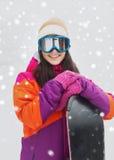 Mujer joven feliz con la snowboard al aire libre Fotografía de archivo