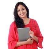 Mujer joven feliz con la tableta contra blanco Imágenes de archivo libres de regalías