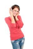 Mujer joven feliz con los auriculares Foto de archivo libre de regalías