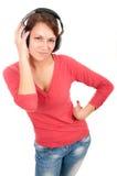 Mujer joven feliz con los auriculares Imagen de archivo libre de regalías