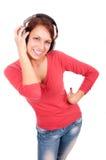 Mujer joven feliz con los auriculares Fotos de archivo