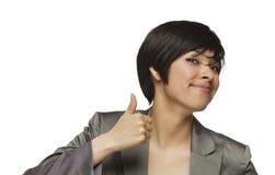 Mujer joven feliz de la raza mezclada con los pulgares para arriba Imagenes de archivo