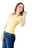 Mujer joven feliz, emocionada que señala en espacio de la copia Imagen de archivo