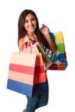 Mujer joven feliz en juerga de compras Imágenes de archivo libres de regalías