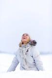 Mujer joven feliz en nieve Imágenes de archivo libres de regalías